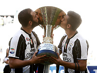 Calcio, Serie A: Juventus vs Crotone. Torino, Juventus Stadium, 21 maggio 2017.<br /> Juventus' Gonzalo Higuain, left, and Paulo Dybala kiss the trophy during the celebrations for the victory of the sixth consecutive Scudetto at the end of the Italian Serie A football match between Juventus and Crotone at Turin's Juventus Stadium, 21 May 2017. Juventus defeated Crotone 3-0.<br /> UPDATE IMAGES PRESS/Isabella Bonotto