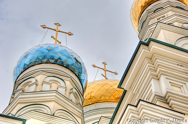 The colorful domes of a Russian Orthodox Church gleam in the midday sun in Vladivostok, Russia