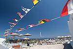 Pennants fly in the blue sky in Oia