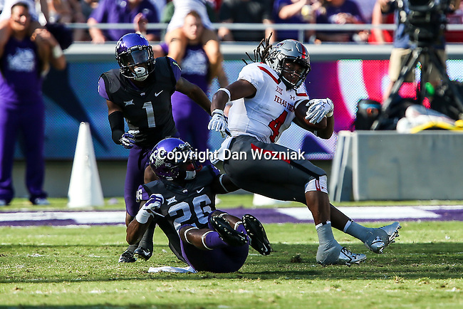 TCU Horned Frogs safety Derrick Kindred (26) and Texas Tech Red Raiders wide receiver Bradley Marquez (4) in action during the game between the Texas Tech Red Raiders and the TCU Horned Frogs at the Amon G. Carter Stadium in Fort Worth, Texas. TCU defeats Texas Tech 82 to 27.