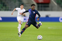 ST. GALLEN, SWITZERLAND - MAY 30: Yunus Musah #10 of the United States looks for an open man downfield during a game between Switzerland and USMNT at Kybunpark on May 30, 2021 in St. Gallen, Switzerland.
