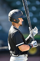 Left fielder Carlos Cortes (8) of the South Carolina Gamecocks takes batting practice before the Reedy River Rivalry game against the Clemson Tigers on Saturday, March 3, 2018, at Fluor Field at the West End in Greenville, South Carolina. Clemson won, 5-1. (Tom Priddy/Four Seam Images)