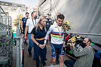 Julian Alaphilippe and his partner Marion Rousse after being celebrated on the big podium in the center of Leuven<br /> <br /> <br /> Elite Men World Championships - Road Race<br /> from Antwerp to Leuven (268.3km)<br /> <br /> UCI Road World Championships - Flanders Belgium 2021<br /> <br /> ©kramon