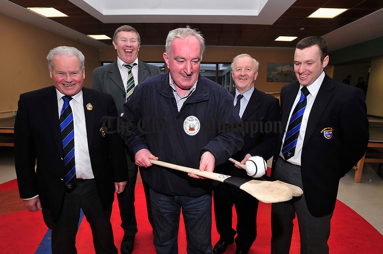 Eamon Moroney from the Pitch Development Committee at Scariff Community College shows off his hurling skills to Ger Hickey, second left, development officer at the Clare County Board and Jimmy O' Gorman, Daniel Nelligan and Robert Frost from the GAA Munster Council. Photograph by Declan Monaghan