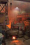 Electric Arc Furnace recycling scrap metal into rebar