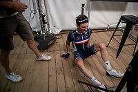 Julian Alaphilippe (FRA/Deceuninck - Quick Step) getting ready for his first flash interview on the live tv-feed as with 20 seconds to go he is struck with severe leg cramps (and even falls off his barstool because of this).<br /> <br /> Elite Men World Championships - Road Race<br /> from Antwerp to Leuven (268.3km)<br /> <br /> UCI Road World Championships - Flanders Belgium 2021<br /> <br /> ©kramon