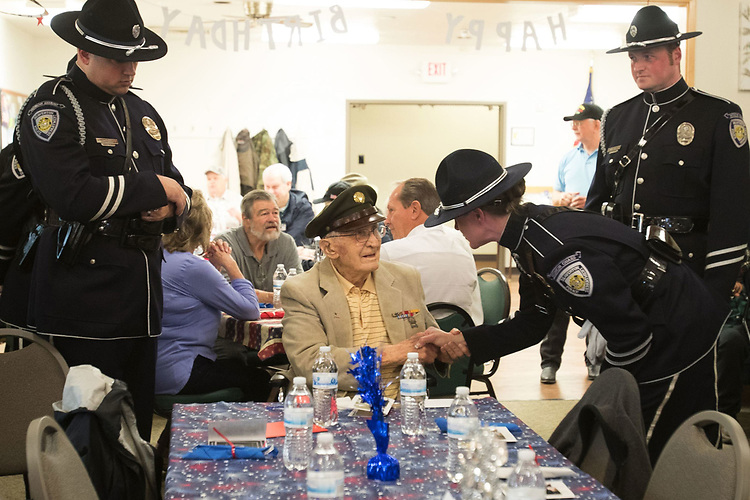 World War II Veteran Ubran Kluthe shakes hands with the  Beaverton City Police Department's Color Guard during his 98th birthday ceremony at the Elsie Stuhr Center.<br /> Photo by Jaime Valdez