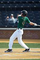 D.J. Poteet (4) of the Wake Forest Demon Deacons follows through on his swing against the Louisville Cardinals at David F. Couch Ballpark on March 17, 2018 in  Winston-Salem, North Carolina.  The Cardinals defeated the Demon Deacons 11-6.  (Brian Westerholt/Four Seam Images)