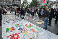 Place de Republique, Paris, France. Six weeks after it began the Nuit de Bout movement host a global day of solidarity atteneded by thousands of activists with meetings and workshops continuing into the night. 15-5-16
