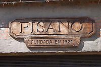 A sign on the winery wall carved in wood and saying the winery was founded in 1924 Bodega Pisano Winery, Progreso, Uruguay, South America
