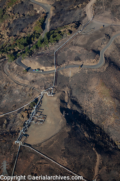aerial photograph of Geyser geothermal pipelines after Kindcade wildfire, Mayacamas Mountains, California
