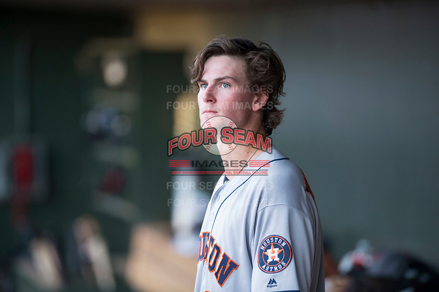 AFL East starting pitcher Forrest Whitley (11), of the Scottsdale Scorpions and the Houston Astros organization, in the dugout before the Fall Stars game at Surprise Stadium on November 3, 2018 in Surprise, Arizona. The AFL West defeated the AFL East 7-6 . (Zachary Lucy/Four Seam Images)