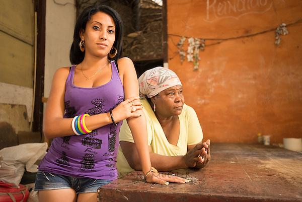 Mother and daughter in their Havana home. (Havana, Cuba)