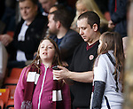 Anxious Hearts fans checking the score from the match in Paisley