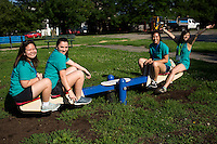 """Members ride a seesaw during """"Circle the City with Service,"""" the Kiwanis Circle K International's 2015 Large Scale Service Project, on Wednesday, June 24, 2015, in the Hawthorne neighborhood in Indianapolis. (Photo by James Brosher)"""