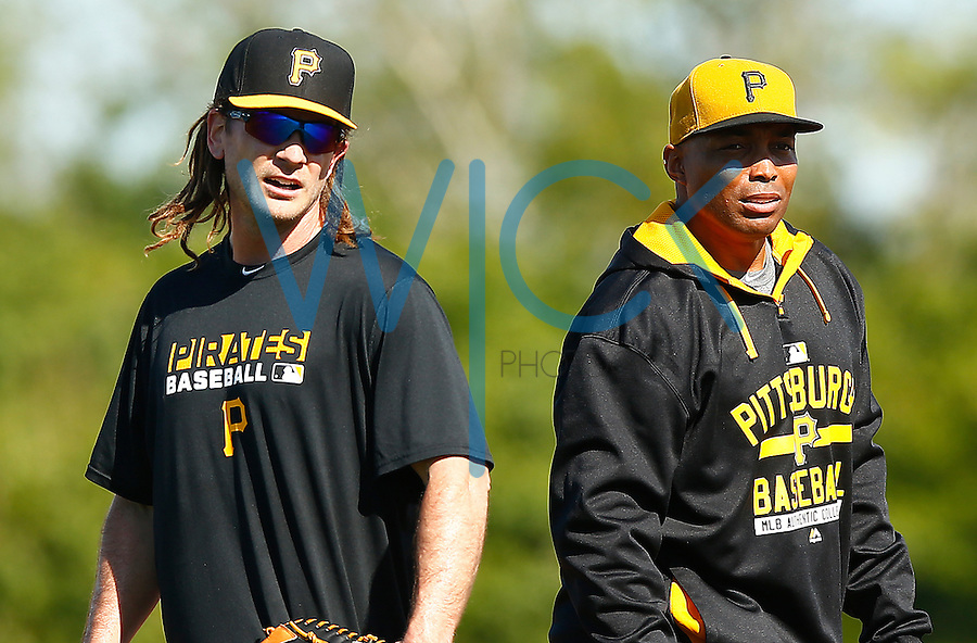John Jaso #28 of the Pittsburgh Pirates and special assistant Kevin Young practice at first base during spring training at Pirate City in Bradenton, Florida on February 17, 2016. (Photo by Jared Wickerham / DKPS)