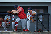 Johnson City Cardinals manager Roberto Espinoza (right) watches from the dugout during the game against the Burlington Royals at Burlington Athletic Stadium on September 4, 2019 in Burlington, North Carolina. The Cardinals defeated the Royals 8-6 to win the 2019 Appalachian League Championship. (Brian Westerholt/Four Seam Images)