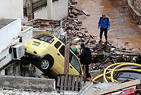 Pictured: A pile of cars adjacent to a block of flats.<br /> Re: Five people have reportedly died and severe damage caused by heavy rain and flash flooding in the area of Mandra, near Athens, Greece. Wednesday 15 November 2017