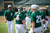 Dartmouth Big Green pitcher Adam Charnin-Aker (left) during practice before a game against the South Florida Bulls on March 27, 2016 at USF Baseball Stadium in Tampa, Florida.  South Florida defeated Dartmouth 4-0.  (Mike Janes/Four Seam Images)