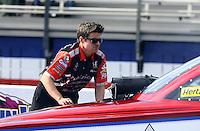 Feb 7, 2014; Pomona, CA, USA; A crew member for NHRA funny car driver Tony Pedregon during qualifying for the Winternationals at Auto Club Raceway at Pomona. Mandatory Credit: Mark J. Rebilas-