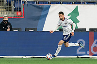 FOXBOROUGH, MA - APRIL 24: Brendan Hines-Ike #4 of D.C. United brings the ball forward during a game between D.C. United and New England Revolution at Gillette Stadium on April 24, 2021 in Foxborough, Massachusetts.