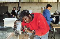 - African immigrant in a company for the production of air conditioning systems ....- immigrato africano in una ditta per la produzione di impianti condizionamento aria