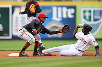 Richmond Flying Squirrels shortstop Rando Moreno (17) takes a throw as Wynton Bernard (36) steals second during a game against the Erie Seawolves on May 19, 2015 at Jerry Uht Park in Erie, Pennsylvania.  Richmond defeated Erie 8-5.  (Mike Janes/Four Seam Images)