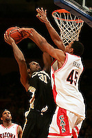 Wake Forest's Eric Williams, #31, goes up for two with Arizona's Channing Frye, #45, defending.  Arizona vs. Wake Forest in men's college basketball in the NIT tournament at Madison Square Garden in Manhattan.  Wake Forest won the game 63 - 60.
