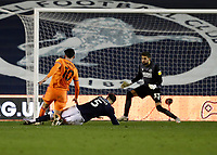 21st November 2020; The Den, Bermondsey, London, England; English Championship Football, Millwall Football Club versus Cardiff City; Kieffer Moore of Cardiff City shoots past Jake Cooper of Millwall to score his sides 1st goal in the 79th minute to make it 1-1