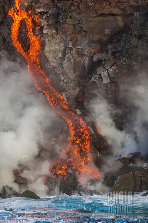 Lava streams enter the ocean near Kalapana on the Big Island of Hawai'i.