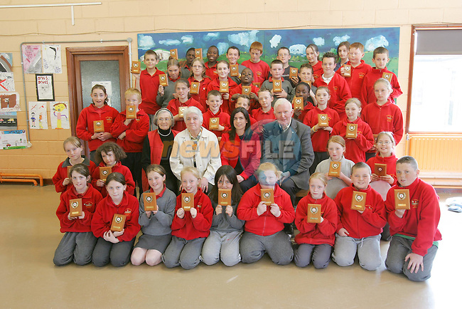 St pauls N.S. students with there plaques in the 'Pioneer Poster CompetitionÕ with Elaine Grennan of Drogheda Concentrates and mambers of the Committee..Photo NEWSFILE/FRAN CAFFREY..(Photo credit should read FRAN CAFFREY/NEWSFILE)...This Picture has been sent you under the condtions enclosed by:.Newsfile Ltd..the Studio,.Millmount Abbey,.Drogheda,.Co Meath..Ireland..Tel: +353(0)41-9871240.Fax: +353(0)41-9871260.GSM: +353(0)86-2500958.email: pictures@newsfile.ie.www.newsfile.ie.FTP: 193.120.102.198..This picture is from Fran Caffrey@newsfile.ie