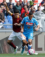 Calcio, Serie A: Roma vs Napoli. Roma, stadio Olimpico, 25 aprile 2016.<br /> Napoli's Allan, right, is challenged by Roma's Diego Perotti during the Italian Serie A football match between Roma and Napoli at Rome's Olympic stadium, 25 April 2016.<br /> UPDATE IMAGES PRESS/Riccardo De Luca