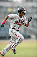 Center fielder Jeremy Fernandez (12) of the Rome Braves runs out a batted ball in a game against the Columbia Fireflies on Tuesday, June 4, 2019, at Segra Park in Columbia, South Carolina. Columbia won, 3-2. (Tom Priddy/Four Seam Images)