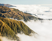 Afternoon coastal views along alpine ranges toward Bruce Bay visible in distance under clouds, , Westland Tai Poutini National Park, UNESCO World Heritage Area, West Coast, New Zealand, NZ