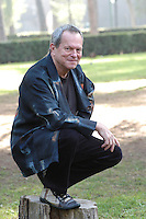 "TERRY GILLIAM.Photocall for the film ""Tideland"", Rome, Italy..October 29th, 2007 .full length black jacket kneeling crouching .CAP/CAV.©Luca Cavallari/Capital Pictures."
