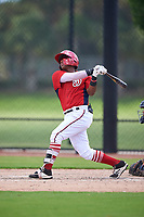 GCL Nationals Edangel Tovar (11) bats during a Gulf Coast League game against the GCL Astros on August 9, 2019 at FITTEAM Ballpark of the Palm Beaches training complex in Palm Beach, Florida.  GCL Nationals defeated the GCL Astros 8-2.  (Mike Janes/Four Seam Images)