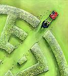 Businessman breaking maze by a lawn mower
