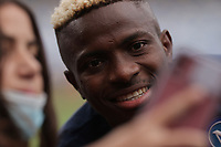 Victor Osimhen of SSC Napoli takes a picture with a fan prior to the Europa league group C 2021/2022 football match between SSC Napoli and FC Spartak Moskva at Diego Armando Maradona stadium in Napoli (Italy), September 30th, 2021. <br /> Photo Cesare Purini / Insidefoto