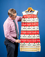 BNPS.co.uk (01202 558833)<br /> Pic: MaxWillcock/BNPS<br /> <br /> Soup-er Stylish Dress<br /> <br /> A soup-er dress made out of paper and designed to look like artist Andy Warhol's famous painting of a tin of Campbell's soup has sold for £2,500.<br /> <br /> The 38ins long item was sold by Woolley and Wallis Auctioneers of Salisbury, Wilts.