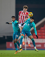 2nd January 2021; Bet365 Stadium, Stoke, Staffordshire, England; English Football League Championship Football, Stoke City versus Bournemouth; Dominic Solanke of Bournemouth wins the ball in front of Harry Souttar of Stoke City and Junior Stanislas of Bournemouth