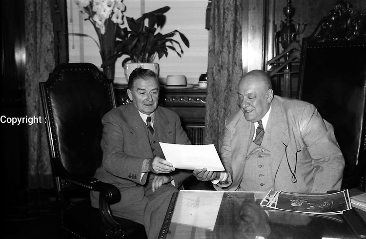 File Photo - Quebec Premier Maurice Duplessis (L) visit Montreal Mayor Camilien Houde at Montreal City Hall, August 9, 1949.