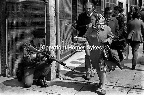 Derry city centre, British soldier on patrol.  1979....