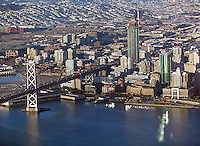 aerial photograph of San Francisco Oakland Bay Bridge toward San Francisco One Rincon hill residential towerr under construction