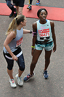 AJ Adudu<br /> carried away by St John's Ambulance at the finish line on The Mall at the 2017 London Marathon, London. <br /> <br /> <br /> ©Ash Knotek  D3254  23/04/2017