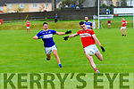 Daingean Uí Chúis Pól Ó Géibheannaigh in possession of the ball closely watched by Templenoe Brian Crowley during the CSFC match at Pairc an Aghasaigh, Dingle, on Saturday evening.