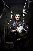Bernard Lavergne, independent producer of foie gras, poses for the photographer with one of his force-fed geese, Courbiac de Tournon, France, Monday, November 22, 2010.