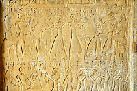 Egyptian funerary Stele from the New Kingdom Period, 1550-1070 B.C, from Thebes (Luxor). The stele is from a carpenters grave a shows at the top left sitting with his wife Amon-Mose holding a chisel between 2 wheat heads. Opposite them their son Honsu is offering a present to both. On the right Neferonpet is making an offering to his parents. At the bottom a sitting couple are offered presents by their sons & daughters. Istanbul Archaeological Museum Inv. no 10865