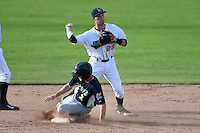 Jamestown Jammers second baseman Erik Forgione (25) attempts to turn a double play as Brett Vertigan (2) slides in during a game against the Vermont Lake Monsters on July 13, 2014 at Russell Diethrick Park in Jamestown, New York.  Jamestown defeated Vermont 6-2.  (Mike Janes/Four Seam Images)