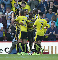 Odion Ighalo of Watford celebrates scoring the opening goal with team-mates   during the Barclays Premier League match Watford and Swansea   played at Vicarage Road Stadium , Watford