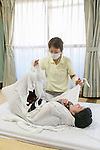A therapist unwraps a woman during an Otonamaki (adult wrapping) therapy session on February 4, 2017, Tokyo, Japan. Otonamaki is a Japanese therapeutic method to reduce stiffness and posture problems. A participant, monitored by a health care professional is wrapped in a large piece of breathable cloth, like a sheet, to alleviate posture problems and body stiffness for about 15 to 20 minutes. The therapy comes from Ohinamaki, the practice of wrapping up babies in cloth in a similar way to give them a feeling of security and help them with their physical development. (Photo by Rodrigo Reyes Marin/AFLO)